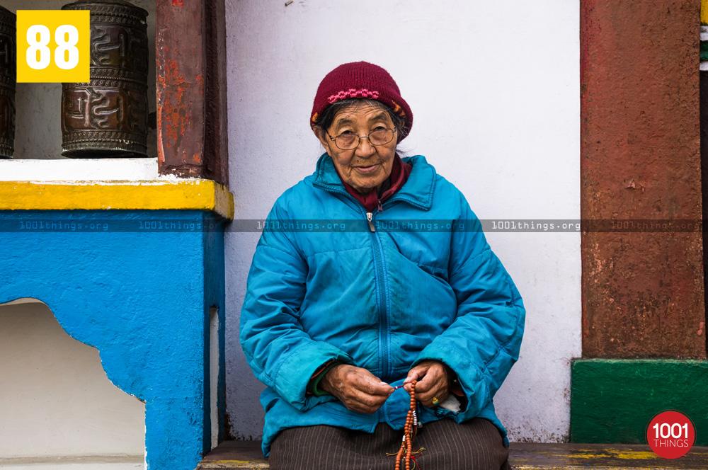Buddhist woman reciting prayers