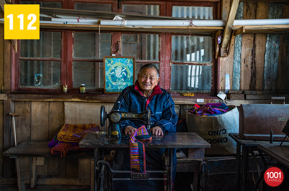 The-old-man-sewing-traditional-item-Tibetan-refugee-self-help-centre
